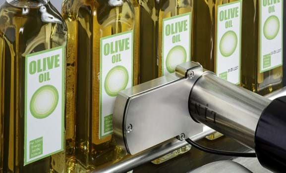 Linx 10 marking olive oil labels on the production line