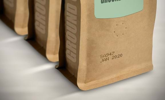 Date code printed on soft paper packaging for coffee
