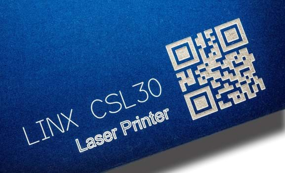 Laser engraved text and QR code on soft textured substrate