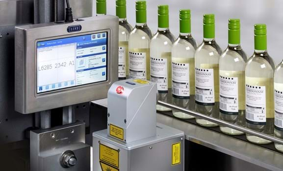 Linx CSL60 marking labels for glass bottle on the production line